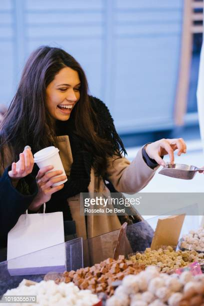 female friends at christmas market - chocolate shop stock pictures, royalty-free photos & images