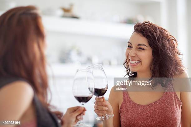 Female friends enjoying a glass of wine