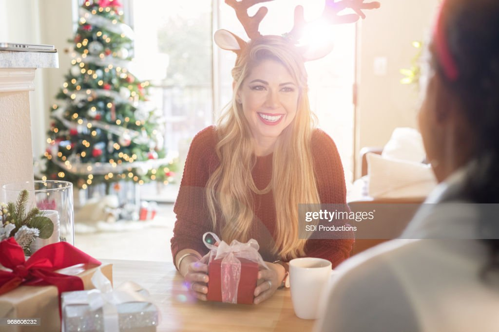 Female Friends Exchange Christmas Gifts Stock Photo | Getty Images