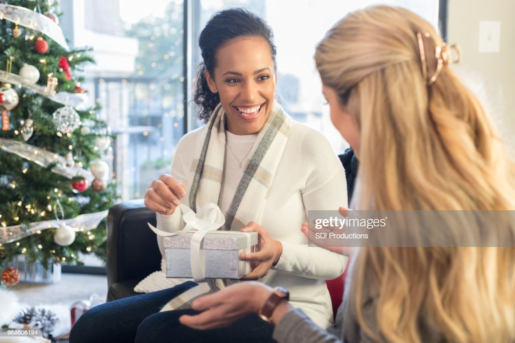 Female Friends Exchange Christmas Presents Stock Photo   Getty Images
