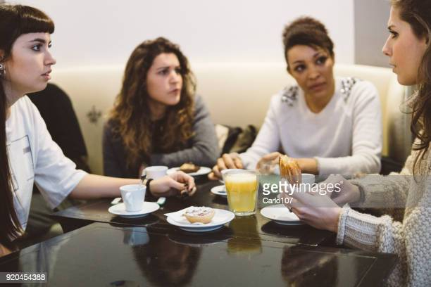 Female friends hanging out at a coffee shop