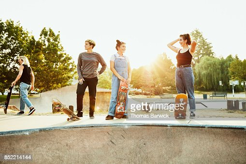 Female friends hanging out during summer morning skate session