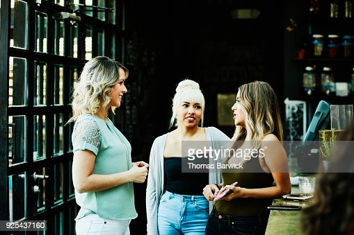 Female friends hanging out together in bar
