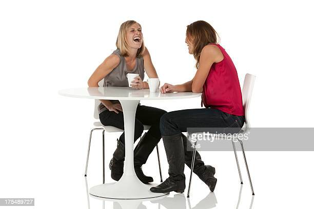 Female friends having coffee in a restaurant