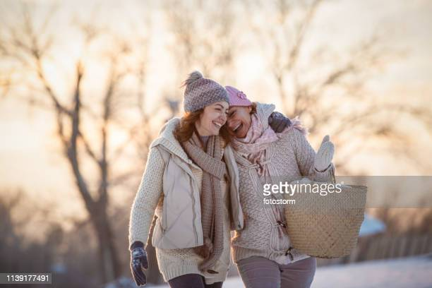 female friends having fun outdoors - mid adult stock pictures, royalty-free photos & images