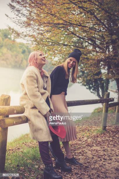 female friends in autumn - gironde stock pictures, royalty-free photos & images