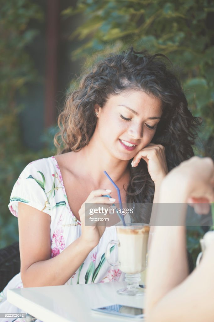 Female friends in cafe : Stock Photo