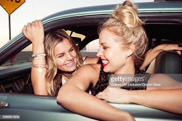 Female friends in car, laughing