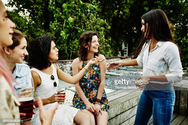 Female friends in discussion during party