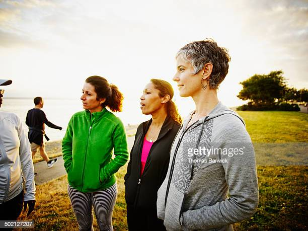 Female friends in discussion in park after run