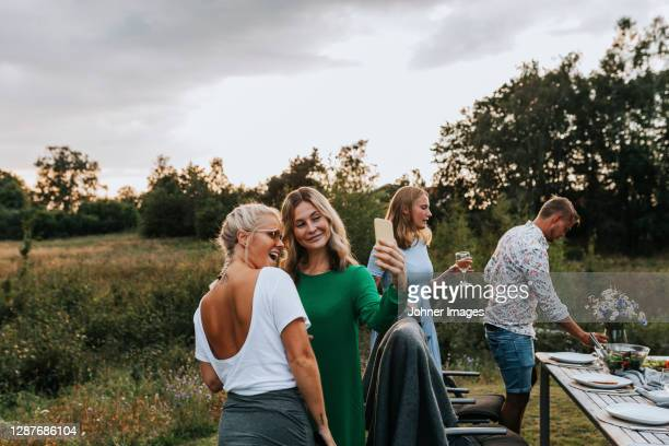 female friends in garden taking selfie - sweden stock pictures, royalty-free photos & images