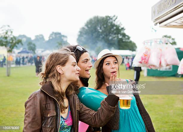 Female friends looking at candyfloss stall.