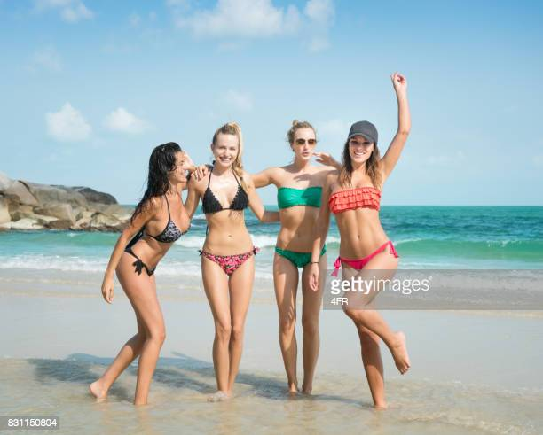 female friends on vacation, girls in bikini having fun at the beach, thailand - asian swimsuit models stock photos and pictures