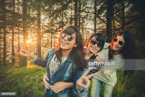 Female friends playing and doing fun together in nature.