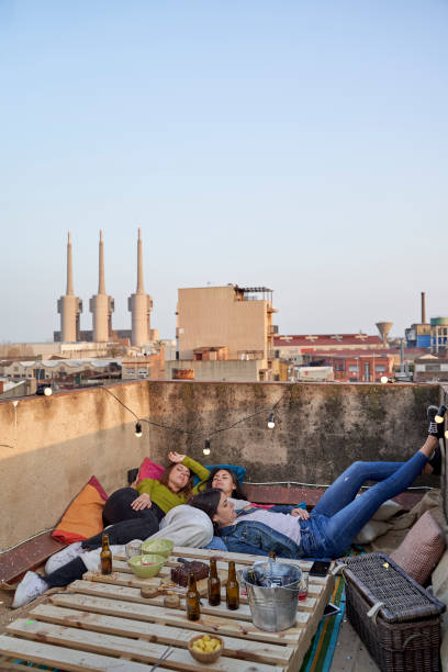 Female friends relaxing on rooftop