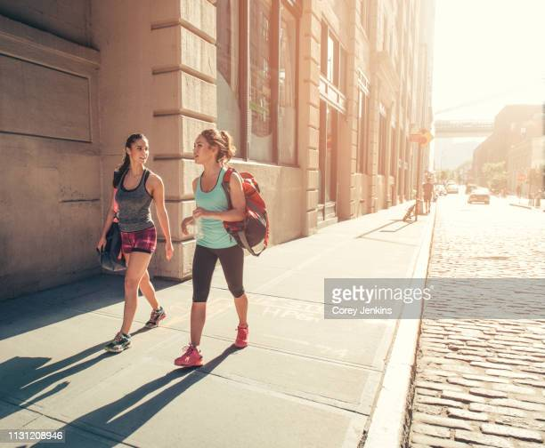 female friends returning from training - sportswear stock pictures, royalty-free photos & images