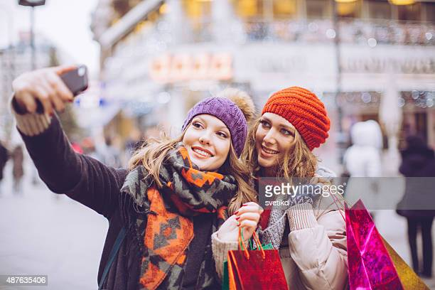 Female friends shopping in city.