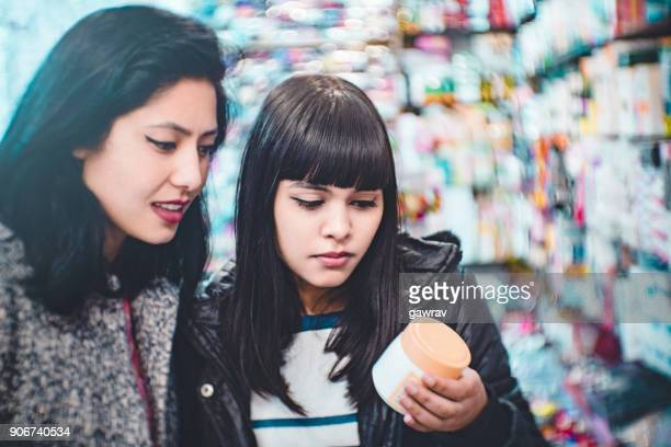 female friends shopping in general store for ladies. - cosmetics stock pictures, royalty-free photos & images