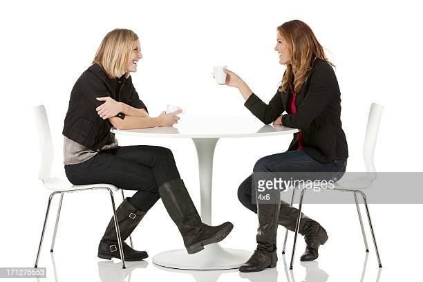 Female friends sitting in a restaurant