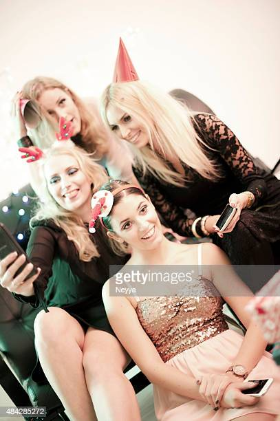 Female Friends Taking Selfie during Christmas Party