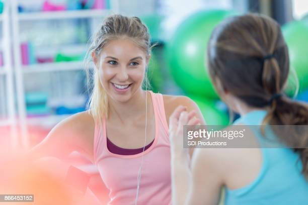 Female friends talk with one another before exercising