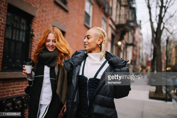 female friends talking on the street in west village, manhattan, ny - generation z stock pictures, royalty-free photos & images