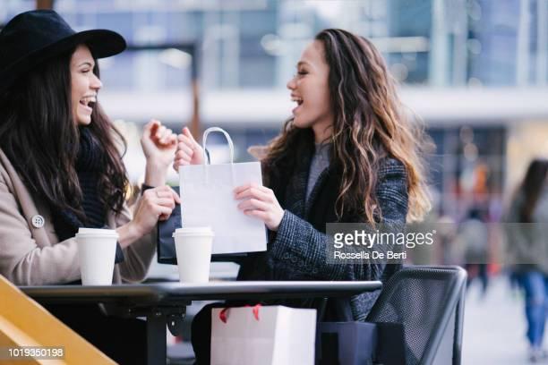 Female friends winter shopping