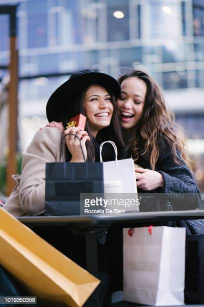female friends winter shopping - exchanging stock pictures, royalty-free photos & images