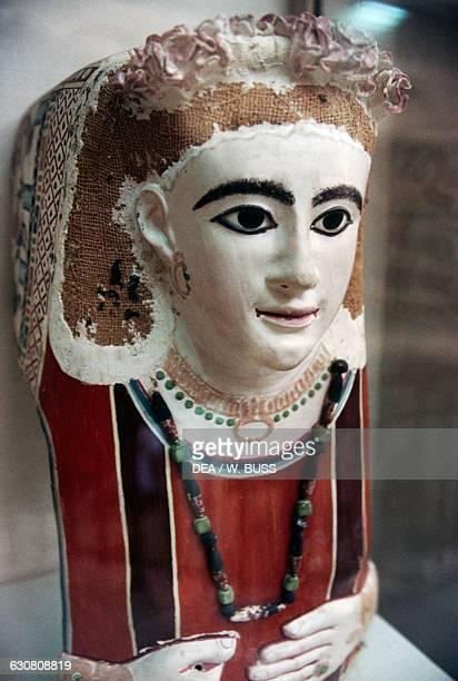 Female funerary mask, painted plaster. Egyptian civilisation, Roman Period, 2nd century AD. Cairo, Egyptian Museum
