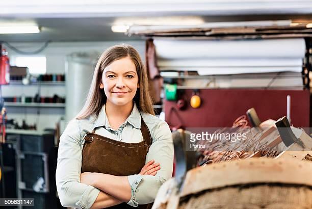 Female furniture restorer at work shop.