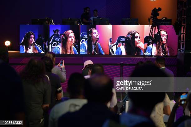 Female gamers play on a giant video screen during the Game XP event at the Olympic Park in Rio de Janeiro Brazil on September 7 2018 The four day...