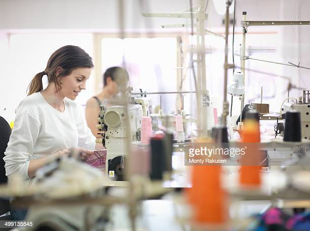 Female garment worker in clothing factory