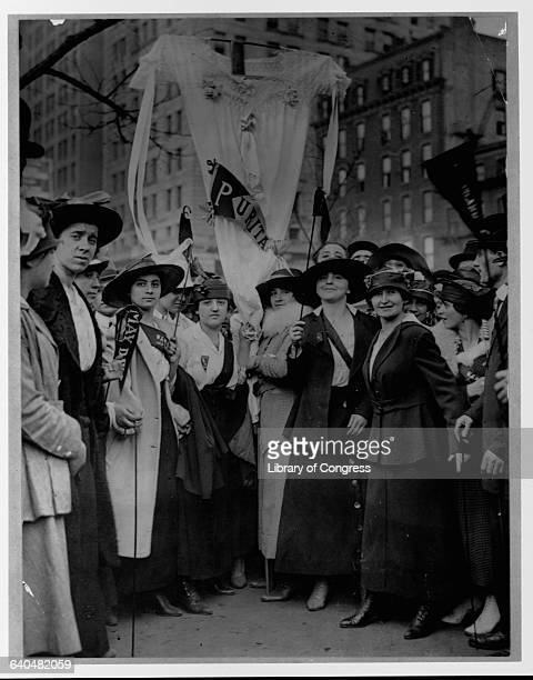 Female garment workers striking on May Day fashion a neglige as a banner ca 1916 New York City