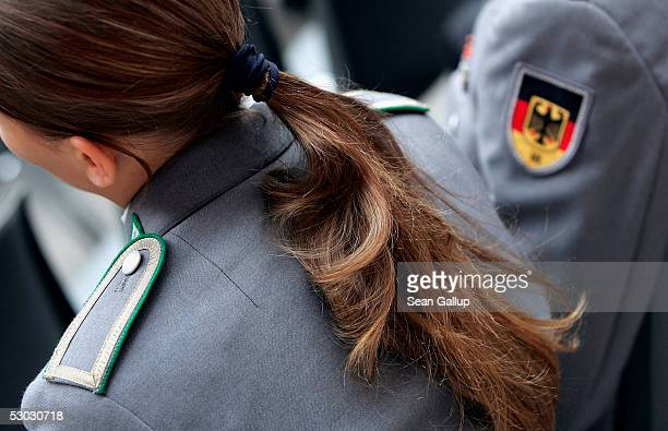 A female German soldier attends celebrations marking the 50th anniversary of the founding of the Bundeswehr modern German armed forces at the...