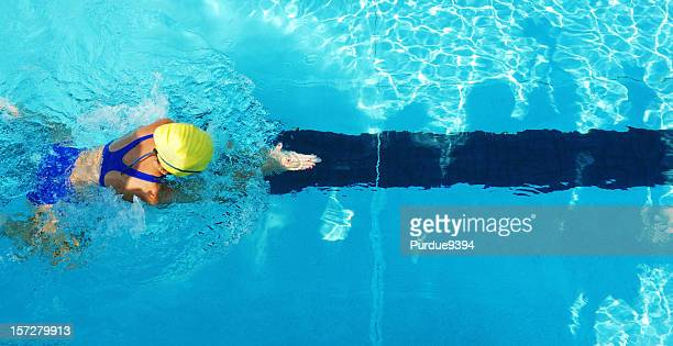 Female Girl Breaststroke Swimmer from Above in Swimming Pool
