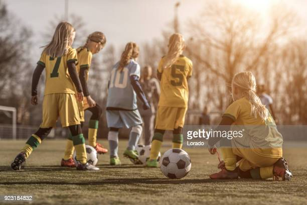 Female Girl Soccer Team during a football training session