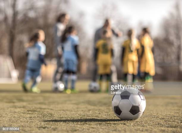 female girl soccer team during football practice - sports equipment stock pictures, royalty-free photos & images