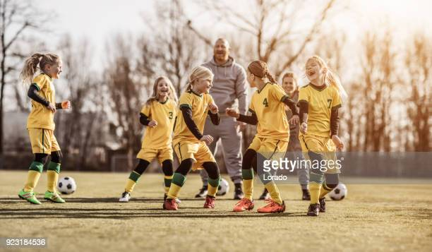 female girl soccer team running drills at football training with their coaches - coach stock pictures, royalty-free photos & images