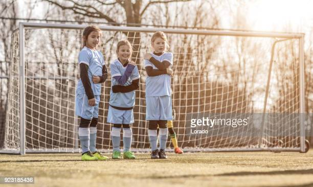Female Girl Soccer Team setting up a defensive wall at a free kick