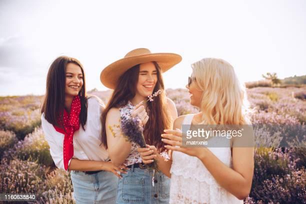 Female girlfriends enjoying summer day in lavender fields