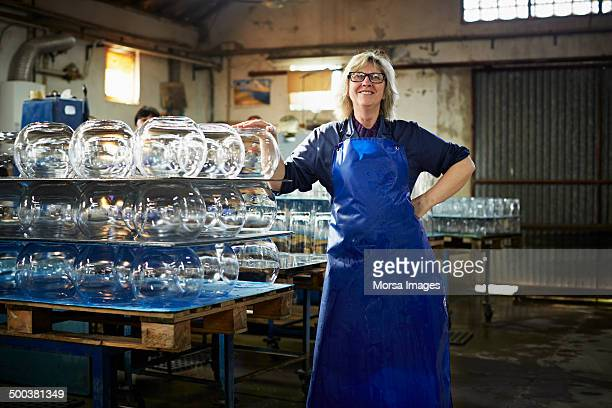 Female glass woker by finished products
