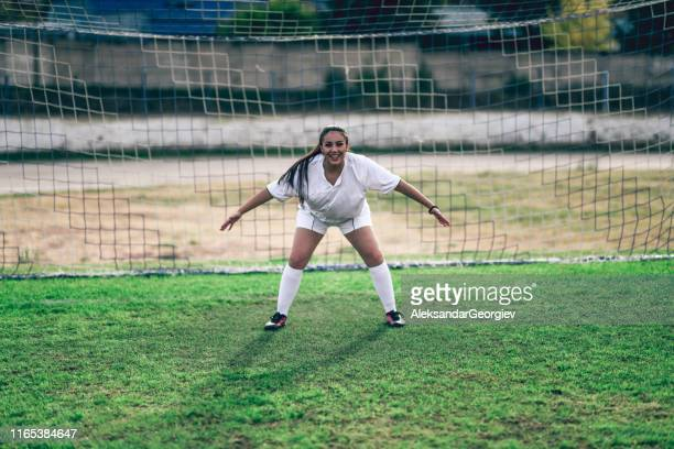 female goalkeeper ready for action - goalkeeper stock pictures, royalty-free photos & images