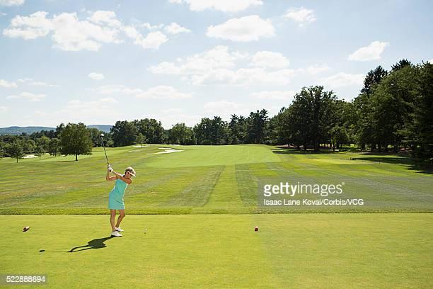 female golfer on golf course - ゴルフのティー ストックフォトと画像