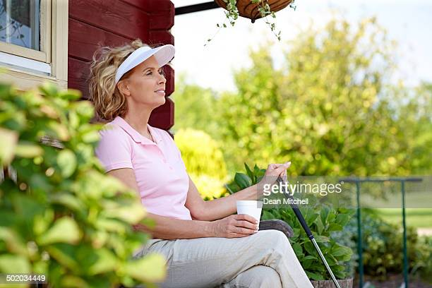 Female golfer resting after a game