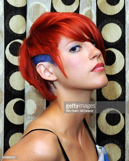 Female gorgeous redhead with extreme cut and blue highlights