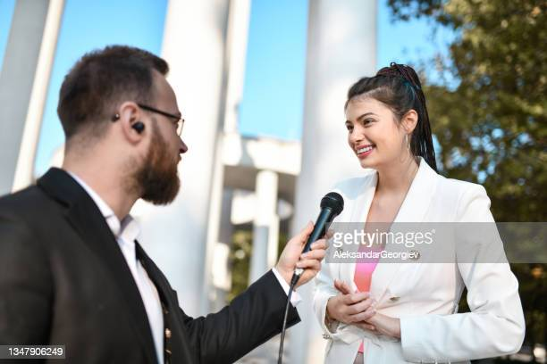 female government official with alternative clothing explaining projects to male journalist - presidential candidate stock pictures, royalty-free photos & images