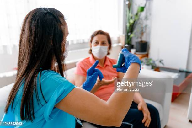 a female g.p. is telling her senior patient about her new medication - recovery stock pictures, royalty-free photos & images