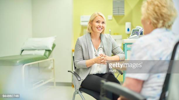 female gp listening to patient - emergency medicine stock pictures, royalty-free photos & images