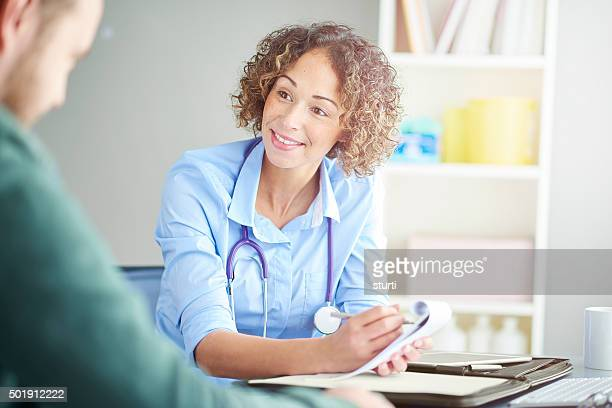 female gp writing a prescription