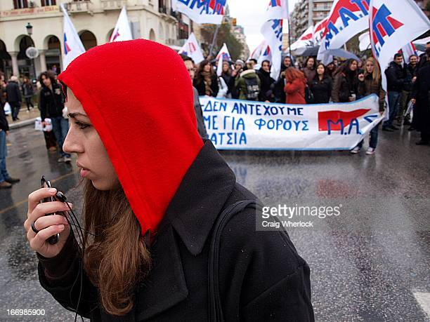 CONTENT] Female Greek student wearing red hoodie takes part in protest Taken during the first day on the Greek general strike called to protest...